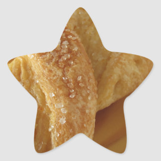 Brioche on a wooden table with granulated sugar star sticker