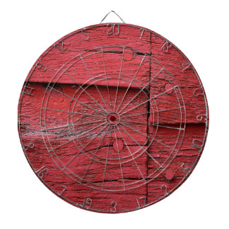 Broadside of the barn red wood dartboard with darts