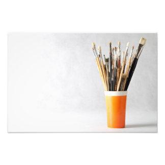 Brochas del arte en taza cojinete