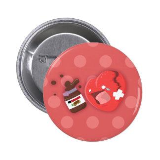 Broken heart needs chocolate pinback button