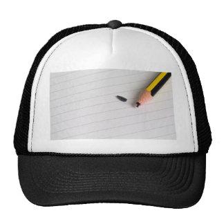 Broken pencil on writing pad mesh hats