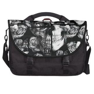 Broken up fractured images of rose skull in black bag for laptop