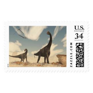 Brontomerus dinosaurs in the desert - 3D render Postage
