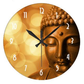 Bronze Buddha Statue with Golden Bokeh Background Clock