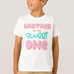 """Brother of the Sweet One Donut 1st Birthday Party T-Shirt<br><div class=""""desc"""">Brother of the Sweet One 1st Birthday Donut Theme party first birthday Cute T-Shirt with """"Brother of the Sweet One"""" design on front for the sibling of the baby birthday girl. Check out matching family birthday shirts for mom, dad, brother and sister, too! For more matching gifts, stationery and home...</div>"""