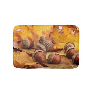 Brown Acorns On Autumn Leaves, Close Up Bath Mats