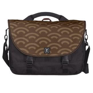 brown and tan shell pattern computer bag