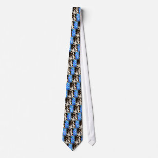 Brown and white coat dog on blue stars background neck tie
