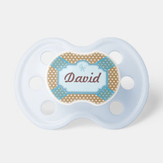 Brown and white dotted with you lasso pacifier