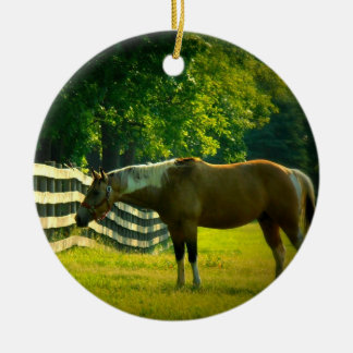Brown and white horse grazing ornament