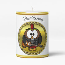 Brown and white owl playing a guitar with red hat pillar candle