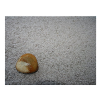 Brown and white round rock on cream carpet posters