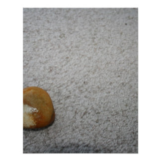 Brown and white round rock on cream carpet print