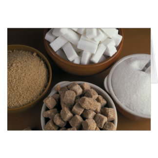 Brown and white sugars in cubes and powder card