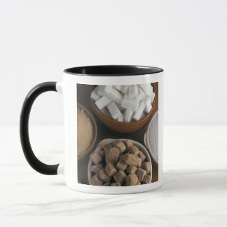 Brown and white sugars in cubes and powder mug