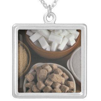 Brown and white sugars in cubes and powder square pendant necklace