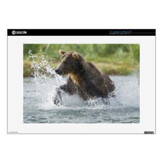 Brown Bear chasing salmon in river Laptop Skins