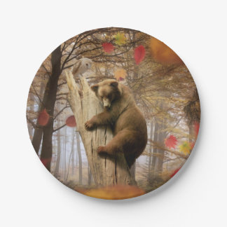 Brown bear climbing on tree paper plate