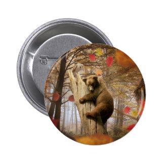 Brown bear climbing on tree pinback button