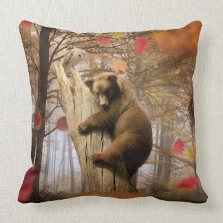 Brown bear climbing on tree throw pillow
