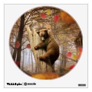 Brown bear climbing on tree wall decal