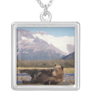 Brown bear, grizzly bear stretching on its back square pendant necklace