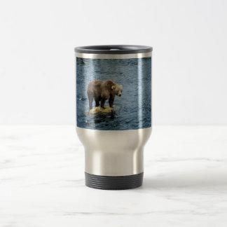 Brown bear on rock in river mugs