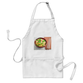 Brown bowl with a portion of cooked rice adult apron