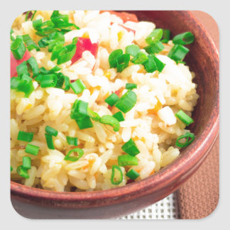 Brown bowl with a portion of cooked rice square sticker