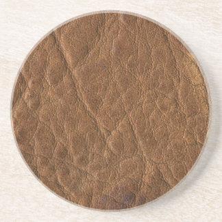 Brown bronceó el fondo de cuero de la textura posavasos para bebidas