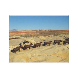 brown cows walking in desert canvas print