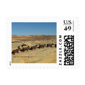 Brown cows walking in desert stamp