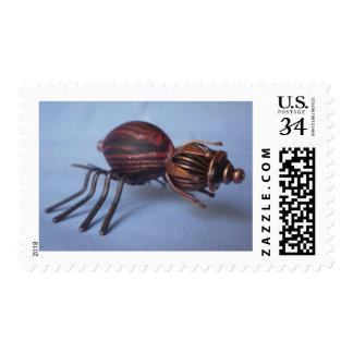 Brown crown beetle stamp