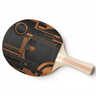brown curcles on black background ping pong paddle