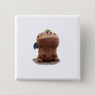 Brown Goofy looking dragon with green eyes Pinback Button