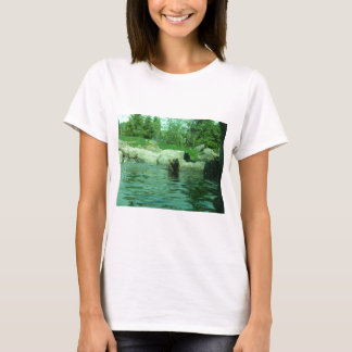 Brown Grizzly Bear swimming in a Pond by Trees T-Shirt
