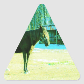 Brown horse in snow by barn triangle sticker