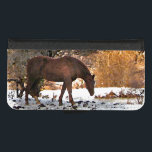 "Brown Horse in Winter iPhone 8/7 Wallet Case<br><div class=""desc"">This iPhone 8/7 phone wallet case features a rural winter scene. A lovely golden brown horse is browsing for fallen apples under the snow,  against a backdrop of bare yellow,  gold and orange hills.</div>"