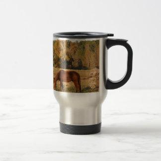 Brown horse in  yellow tree field travel mug