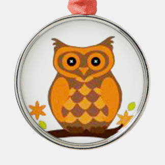 brown owl sitting in a branch metal ornament