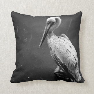 brown pelican near water fish swimming bw throw pillow