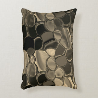 Brown pieces, circles and rounded off forms accent pillow