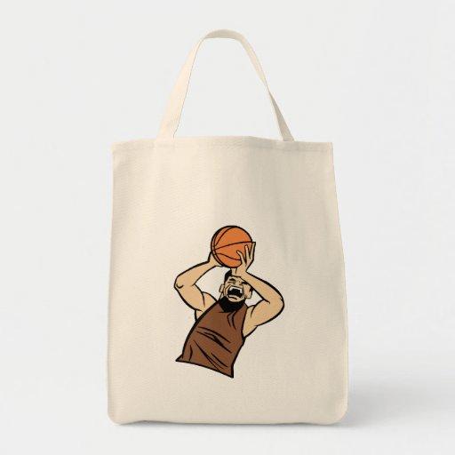 Brown player shooting ball tote bags