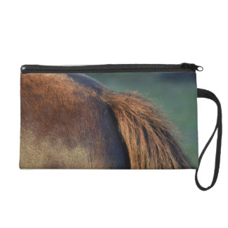 Brown pony hindquarters and tail wristlet purse