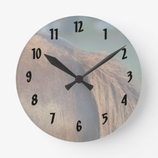 Brown pony hindquarters and tail round wall clock