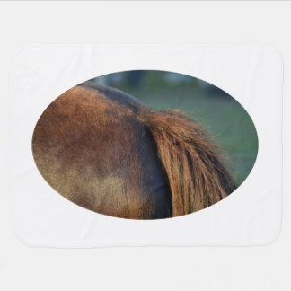 Brown pony hindquarters and tail swaddle blankets