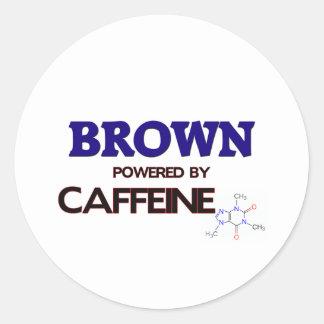 Brown powered by caffeine round sticker