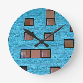 Brown Rectangles in a Wall of Blue Round Wall Clock