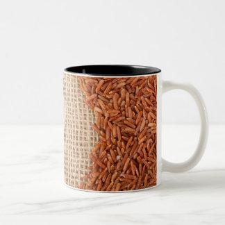 Brown rice on burlap fabric Two-Tone coffee mug