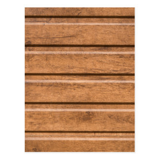 Brown siding that mimics the natural wood postcard